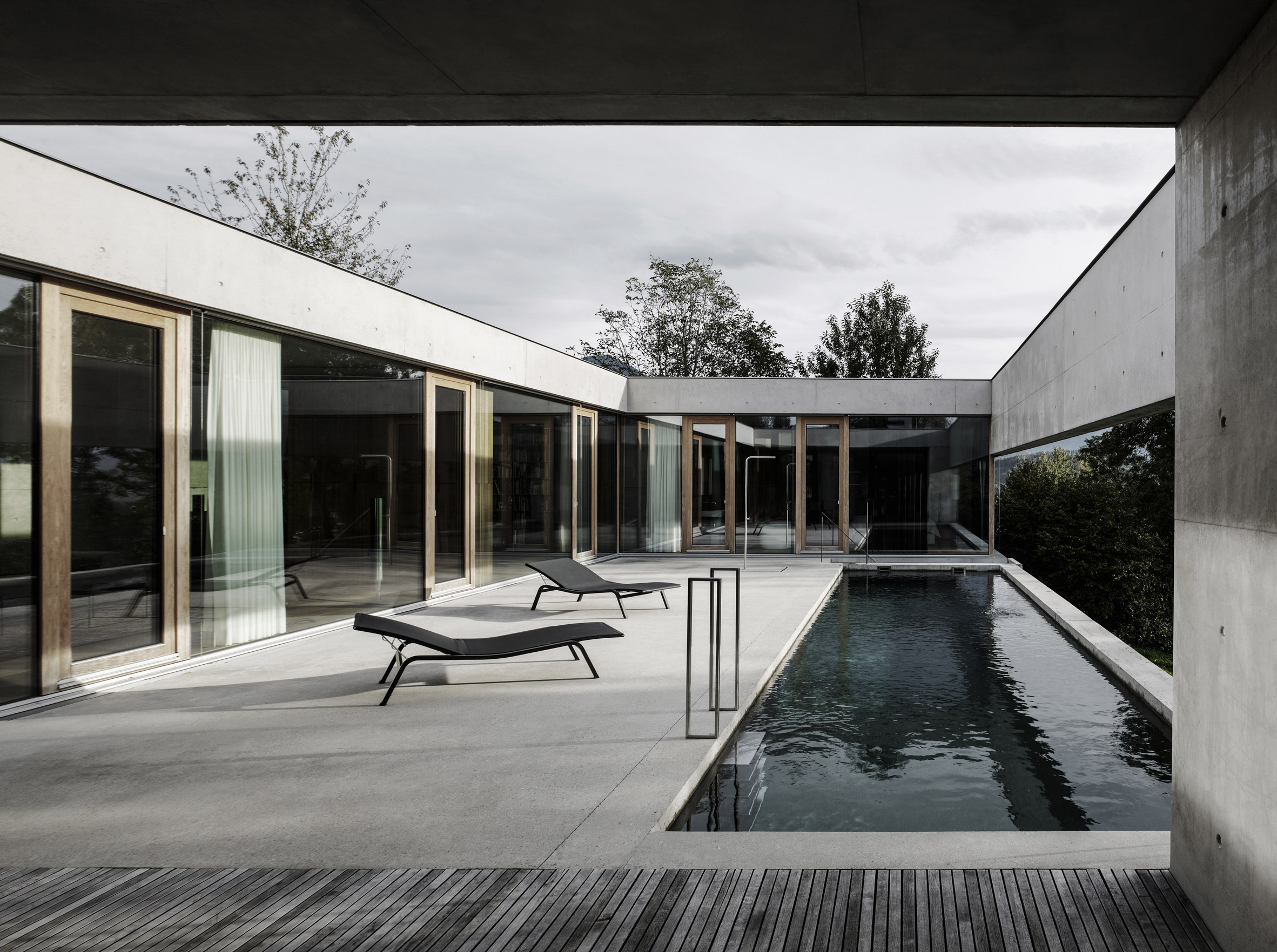Concrete house by Marte.Marte Architects features pool with views of Rhine Valley