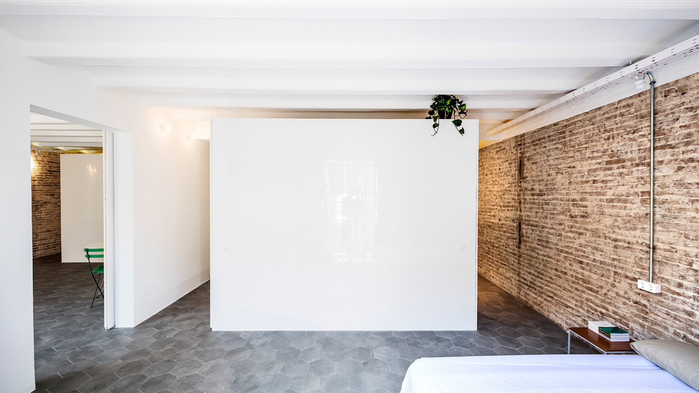 RÄS studio adds pair of white boxes to La Carmina apartment in Barcelona