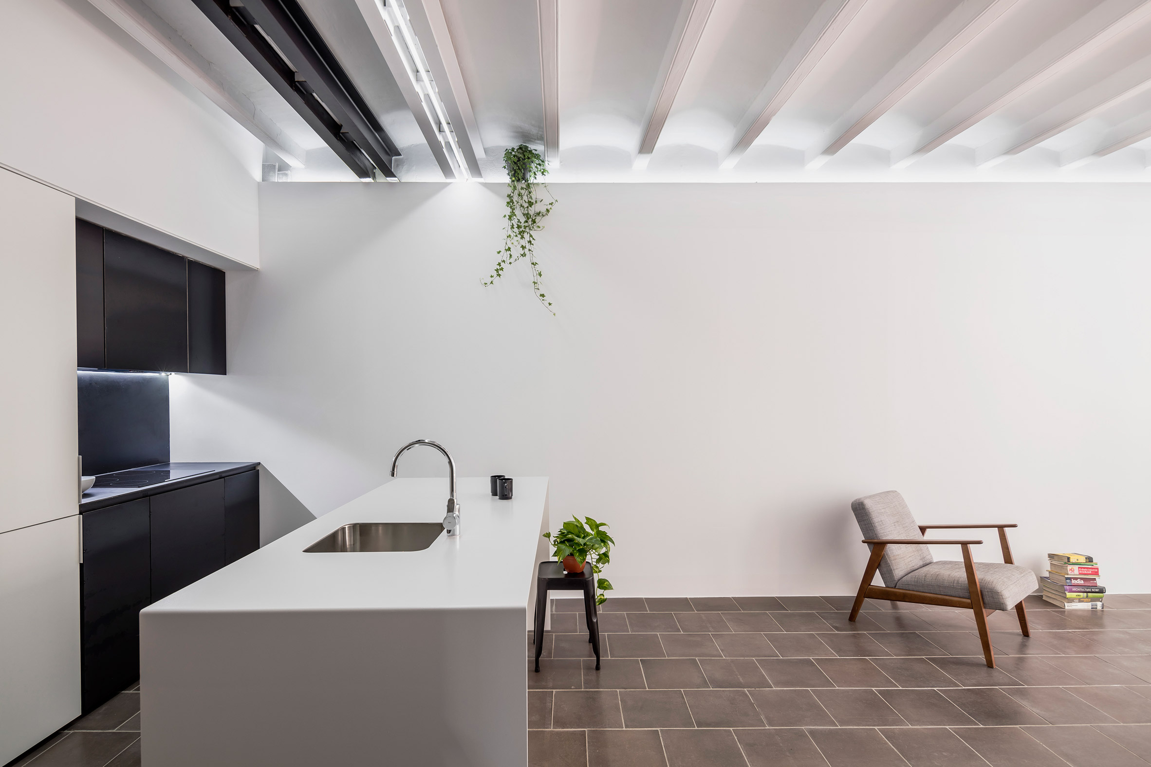 RÄS studio updates Barcelona apartment with monochrome paintwork and textured tiles