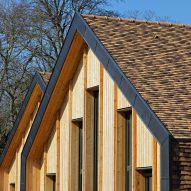 Brown ceramic shingles cover Nomade Architectes' village-inspired nursery near Paris