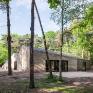Angular brick theatre by Reset Architecture sits in a woodland clearing