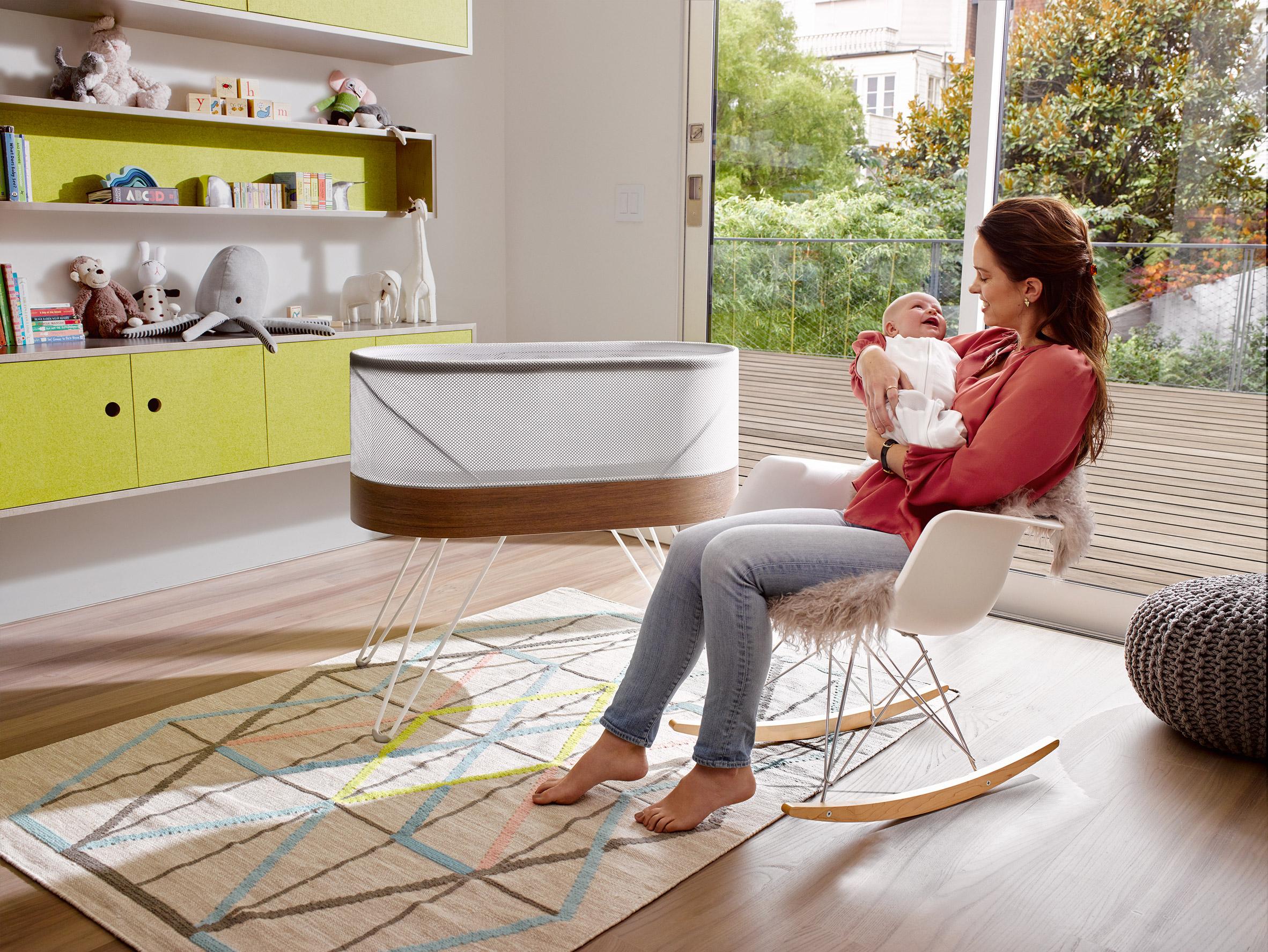 Yves Behar's robotic Snoo crib rocks babies to sleep itself
