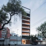 Wedge-shaped balconies front Carlos Marín's skinny apartment block in Mexico City