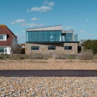 Shoreham Beach House by ABIR Architects features gabion walls filled with beach pebbles