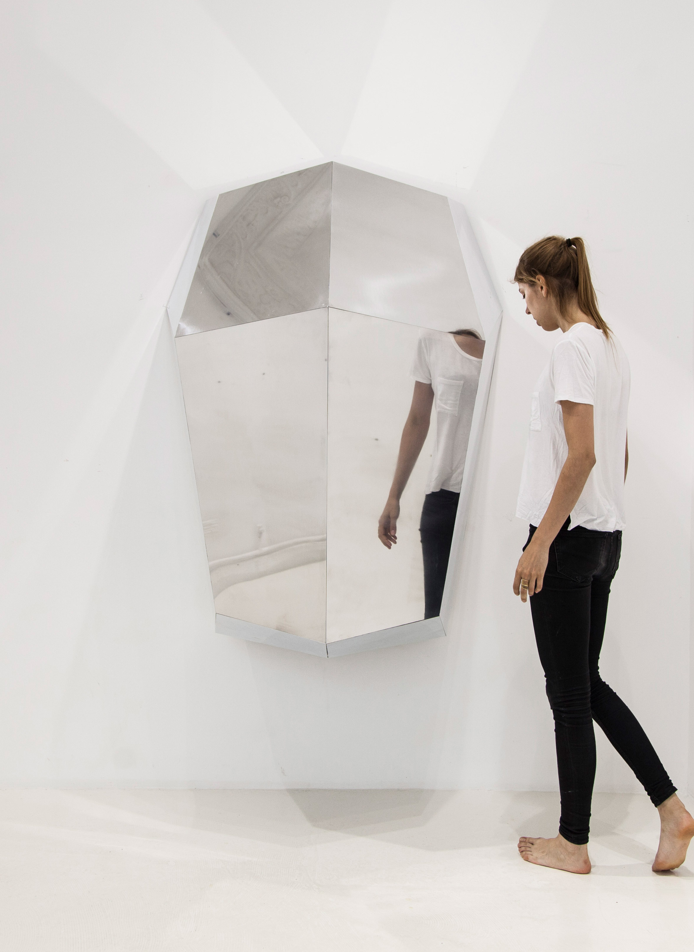 Wall-mounted cubby by Yasmine Benhadj-Djilali provides a private escape for office workers