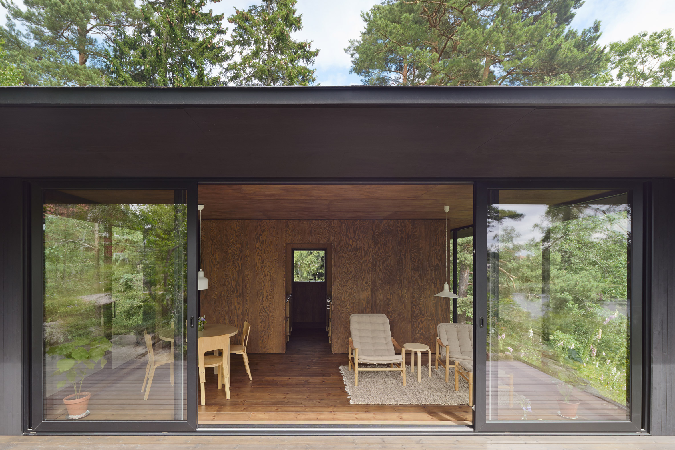 Glass and dark-wood house offers panoramic views of Swedish countryside