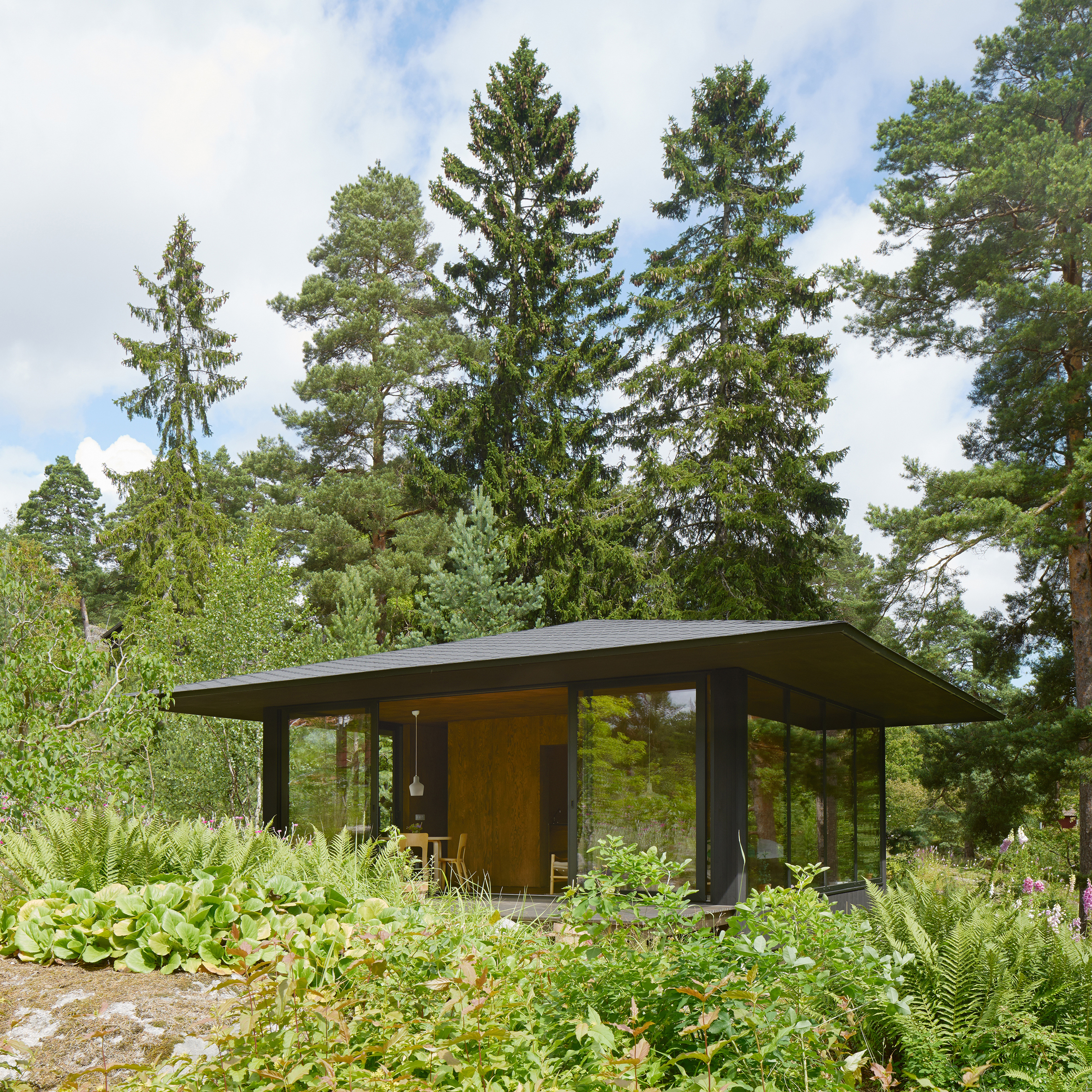 Glass And Dark Wood House Offers Panoramic Views Of Swedish Countryside