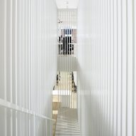 White staircase cuts through Square's New York office by Magdalena Keck