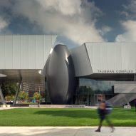 Carbon-fibre orb marks entrance to Detroit academic building by Morphosis