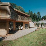 Steam-bent wood wraps house in the Cornish woods