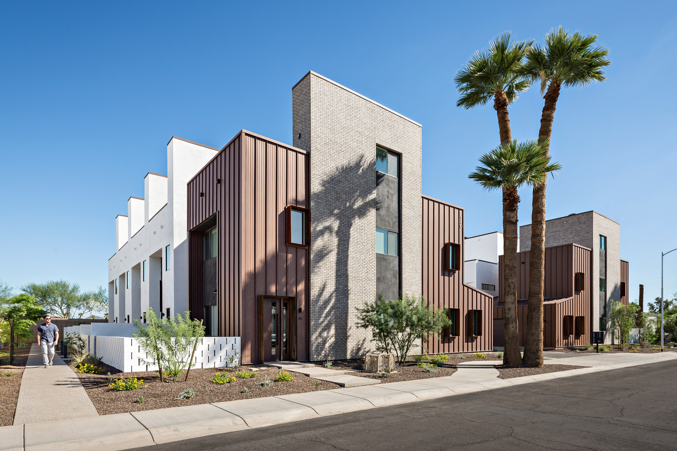 The Ranch Mine clads Phoenix townhouses in brick, stucco and weathering steel