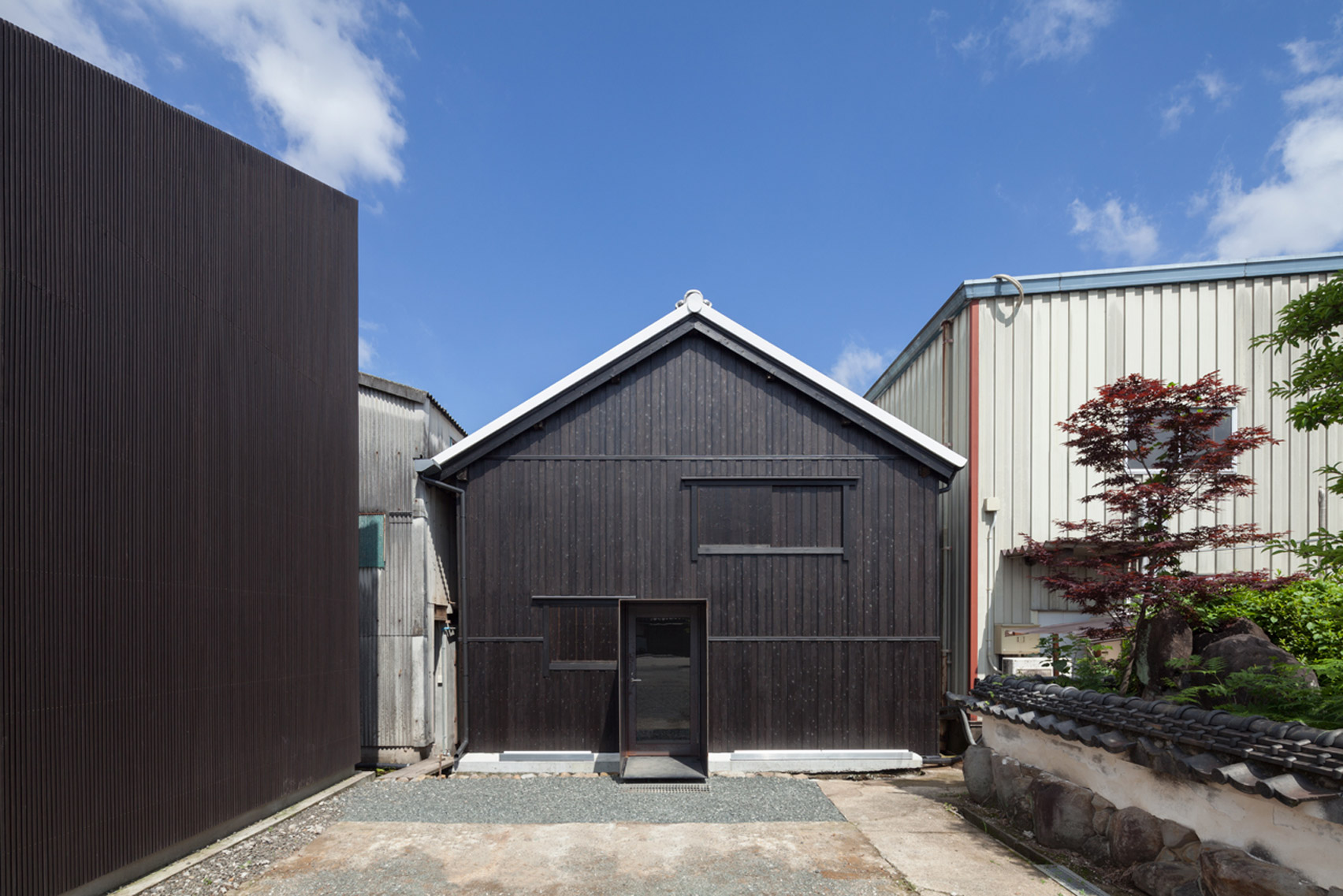 yHa architects converts Japanese sake brewery building into tasting and exhibition space