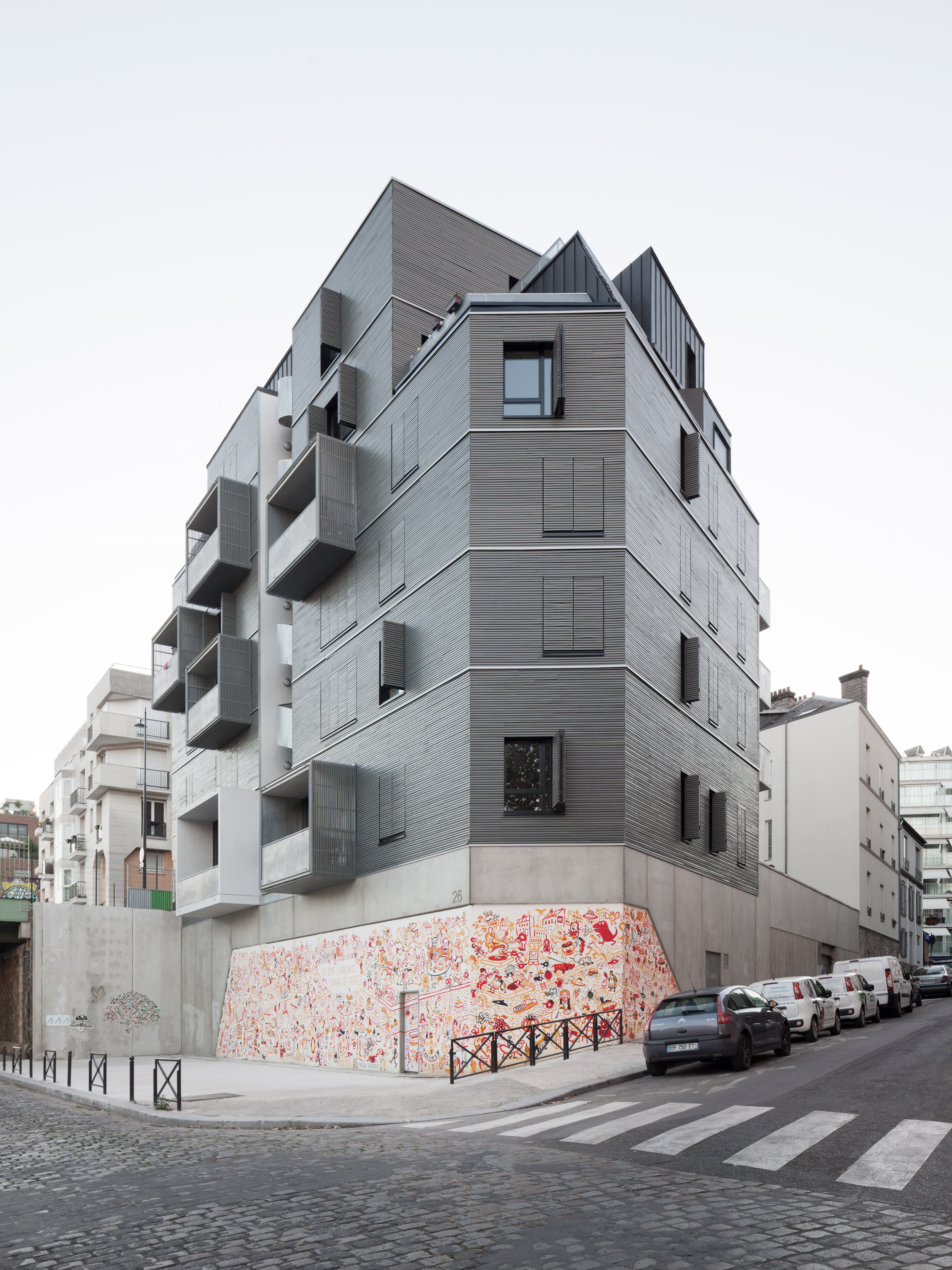 Boxy balconies and spiral staircase feature at Parisian apartment block by Karawitz