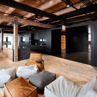 Chicago office by Those Architects features pegboard walls and a baseball batting cage