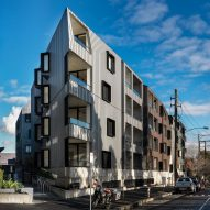 Woods Bagot's zinc-clad apartments echo industrial context in Melbourne
