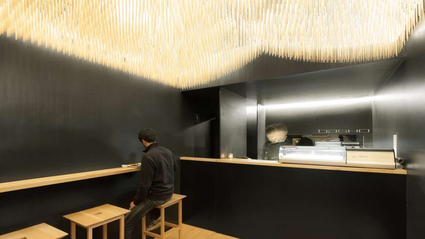 Paulo Merlini suspends chopsticks from ceiling of minimal sushi bar