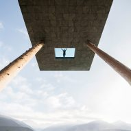 Glass-bottomed pool by NOA projects out from Alpine hotel