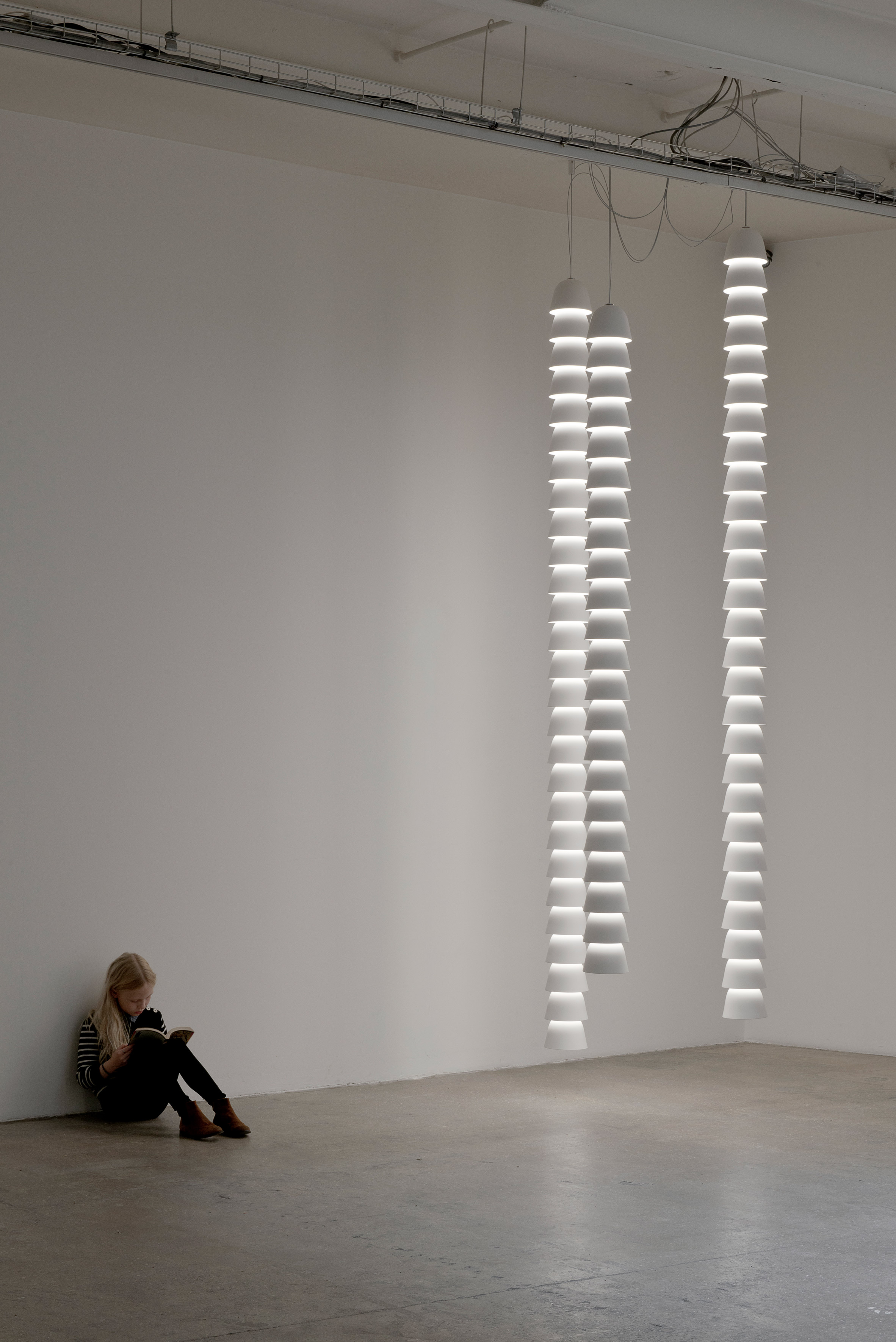 Bouroullec Brothers suspend chains of light from ceiling of Galerie Kreo
