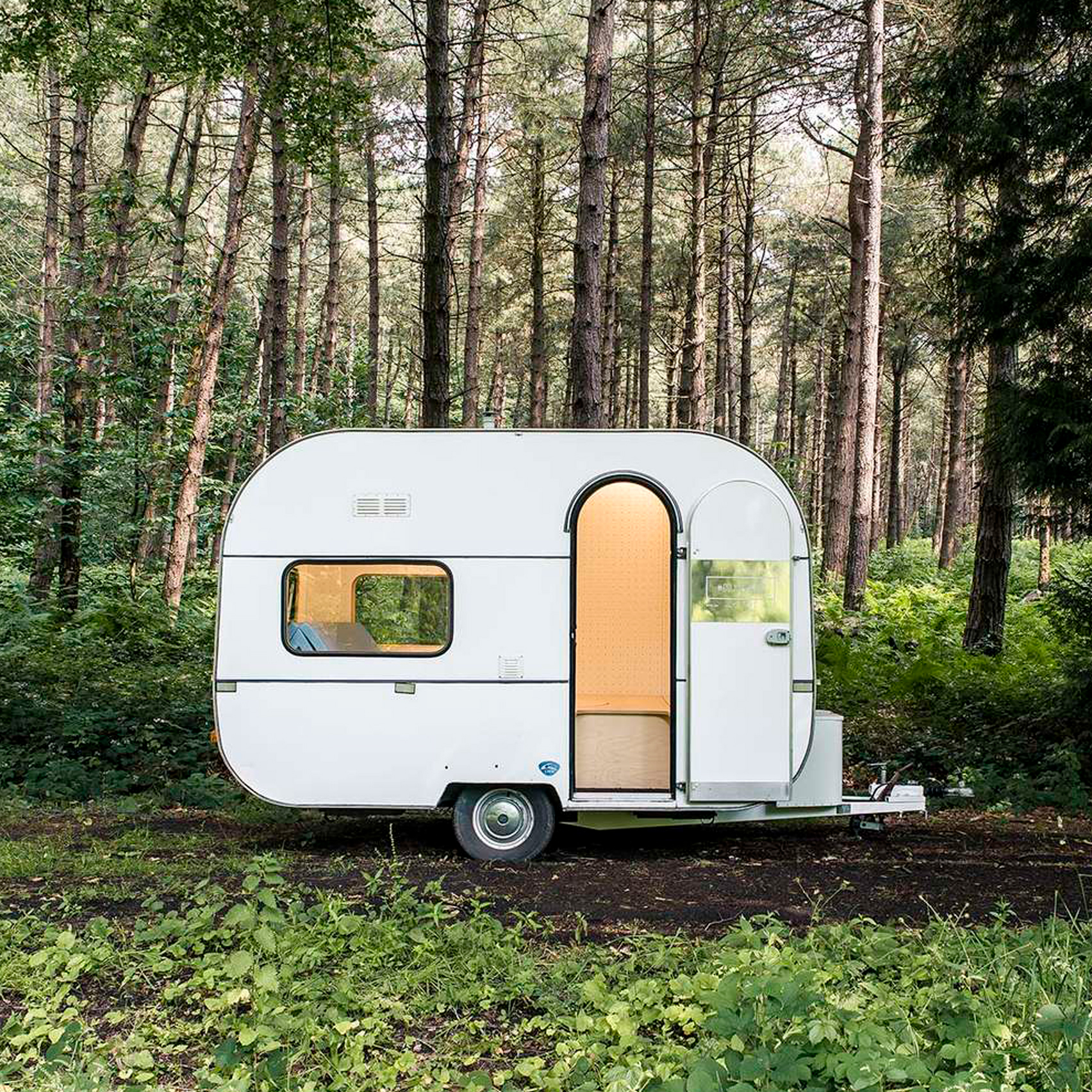 Five AM turns caravan into studio with pop-up table and