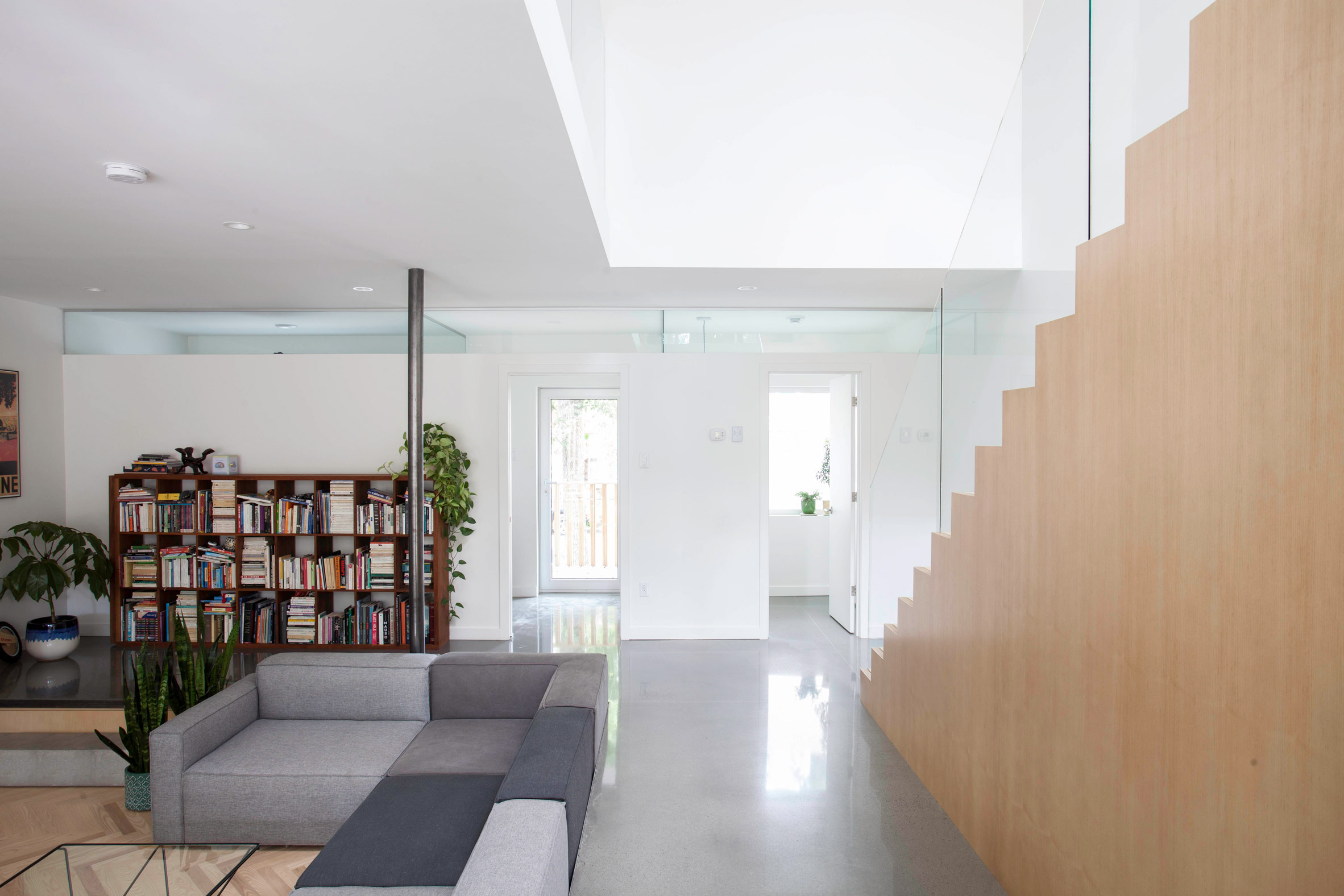 Appareil Architecture merges two Montreal flats to create house with a sunken living room