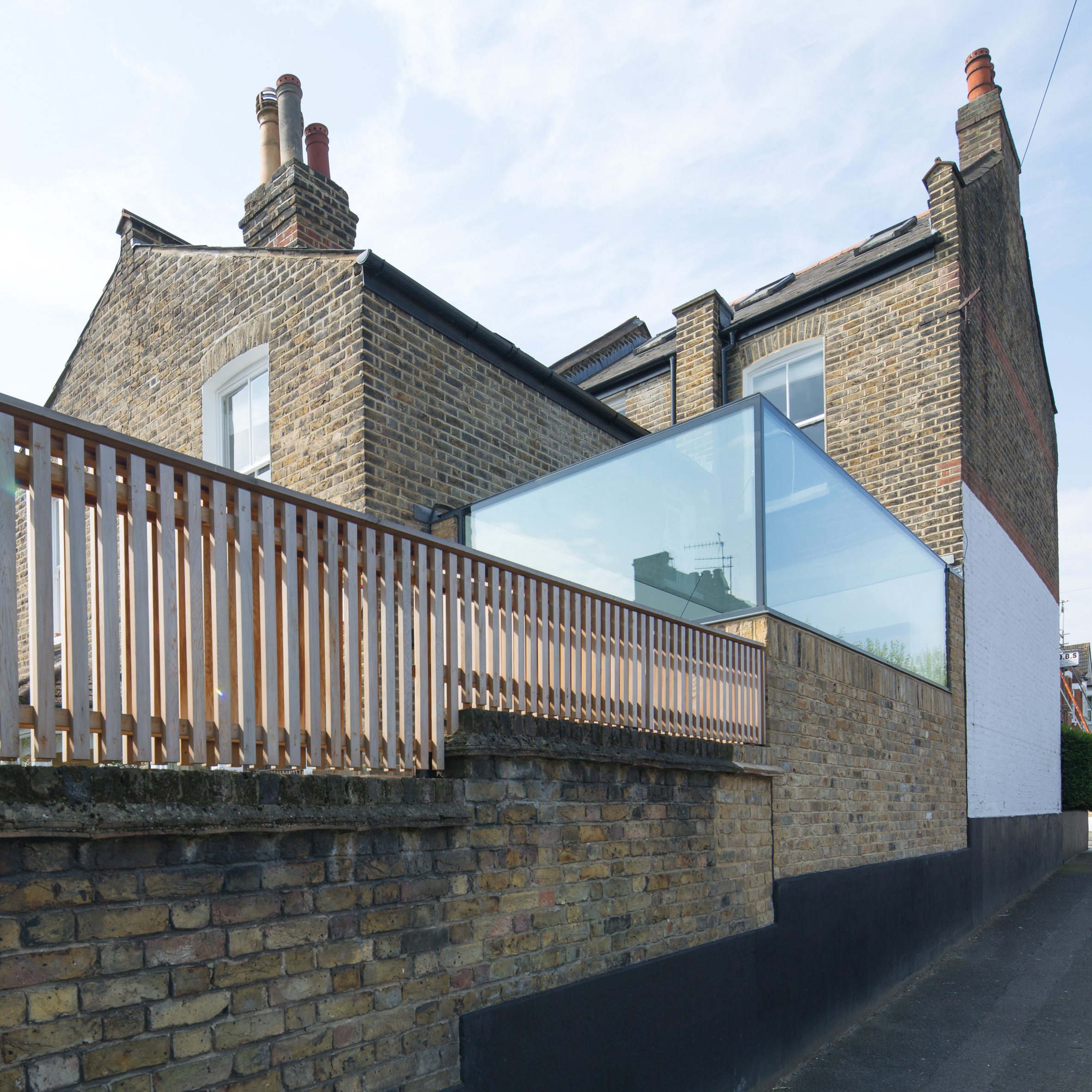 Glass Box extension by Studio 304 sits atop parkside home in Hackney