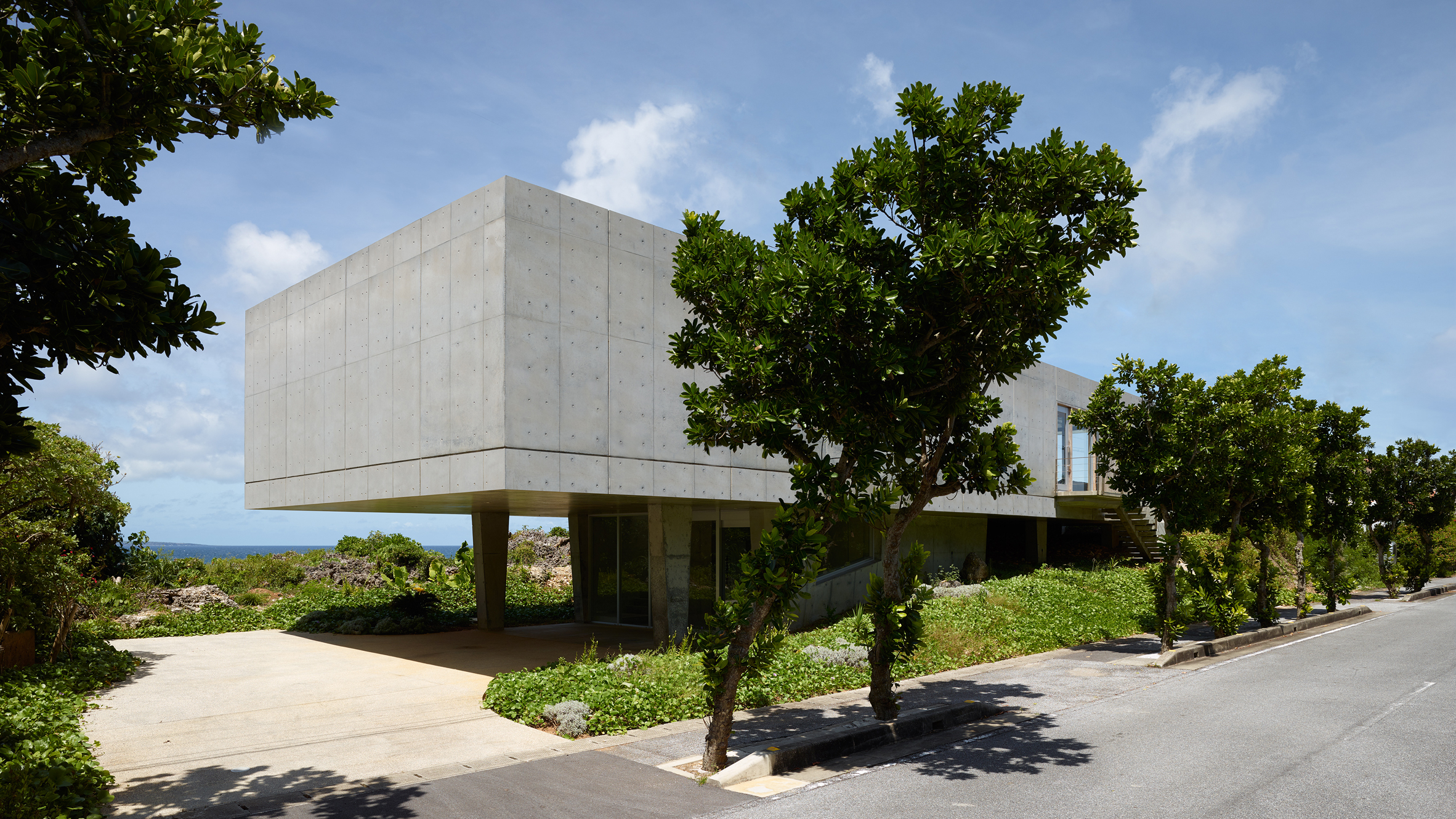 1100 architect elevates concrete house above a bluff on a tiny japanese island