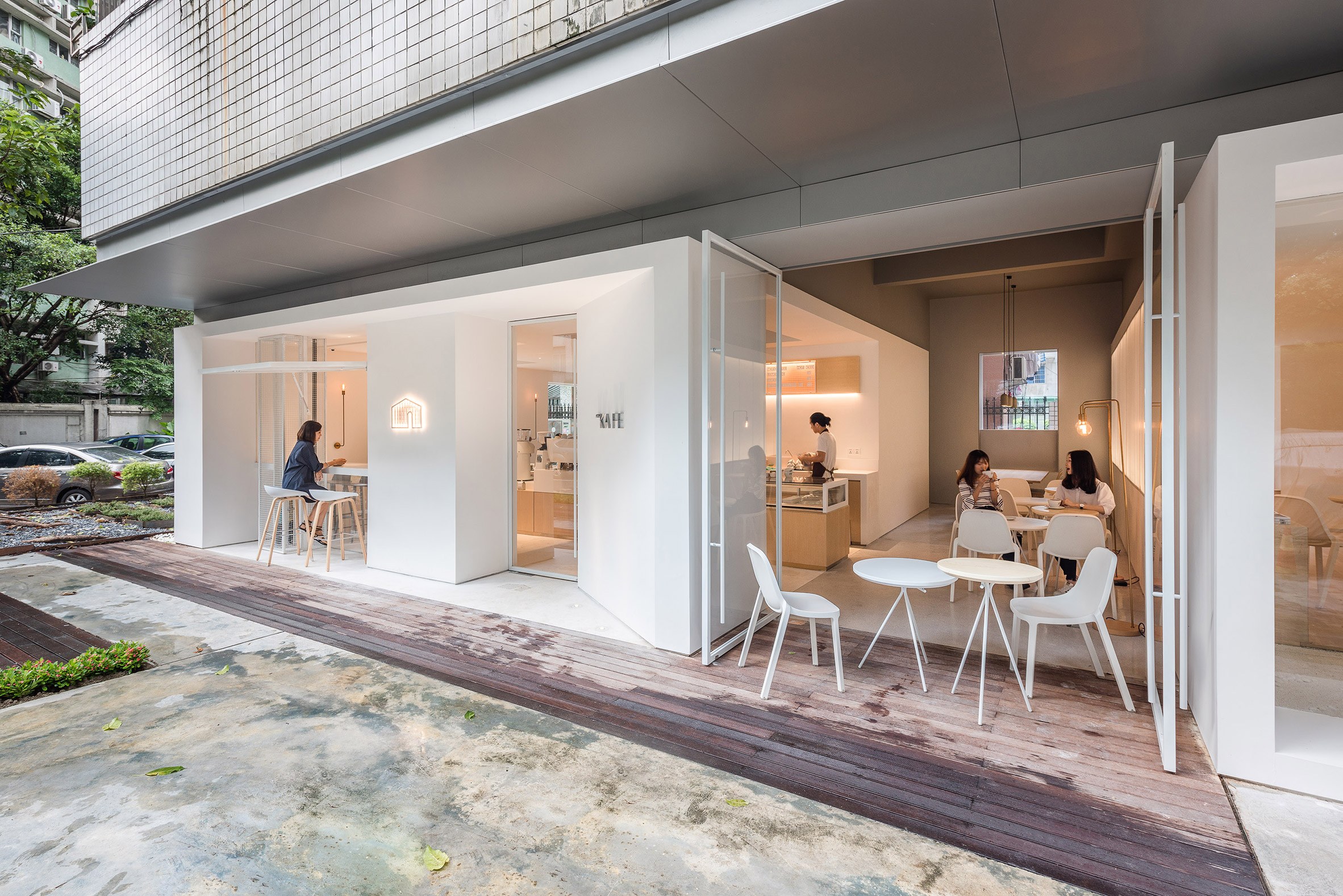 White boxes frame different areas inside Guangzhou coffee shop and co-working space
