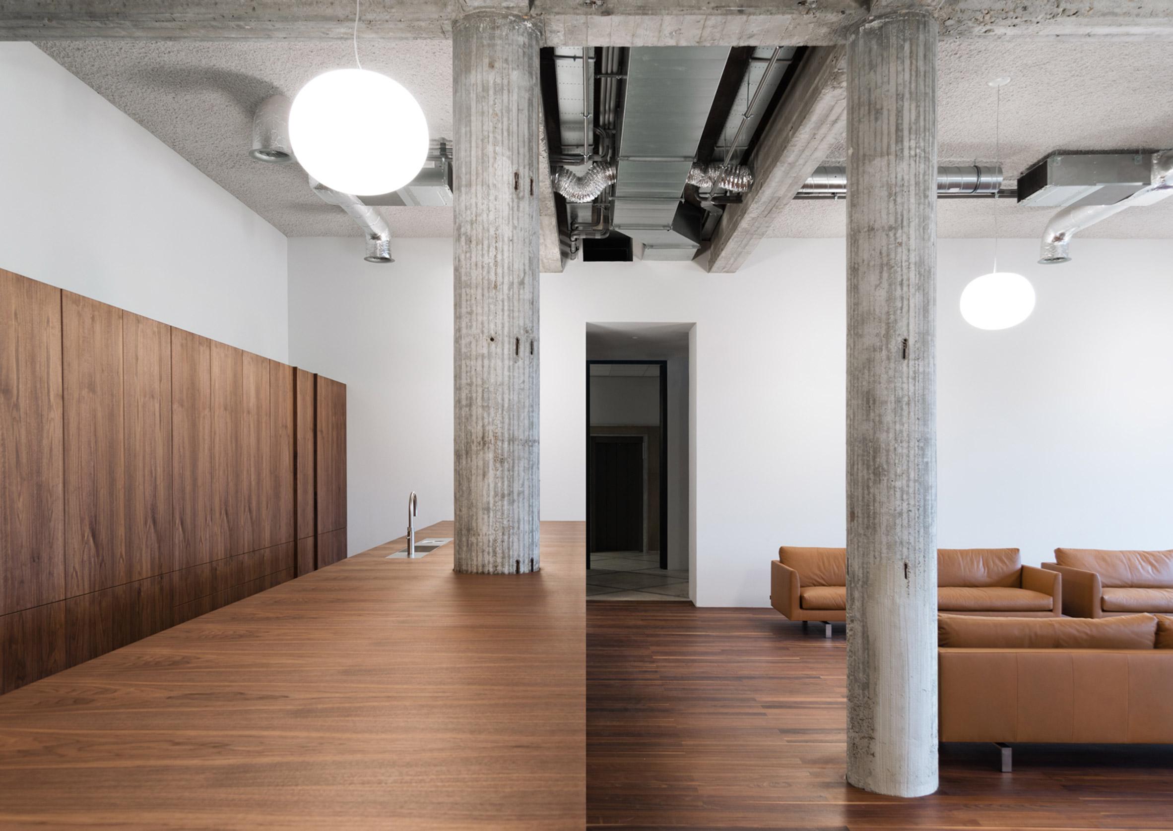 KAAN Architecten transforms Rotterdam bank into riverside studio