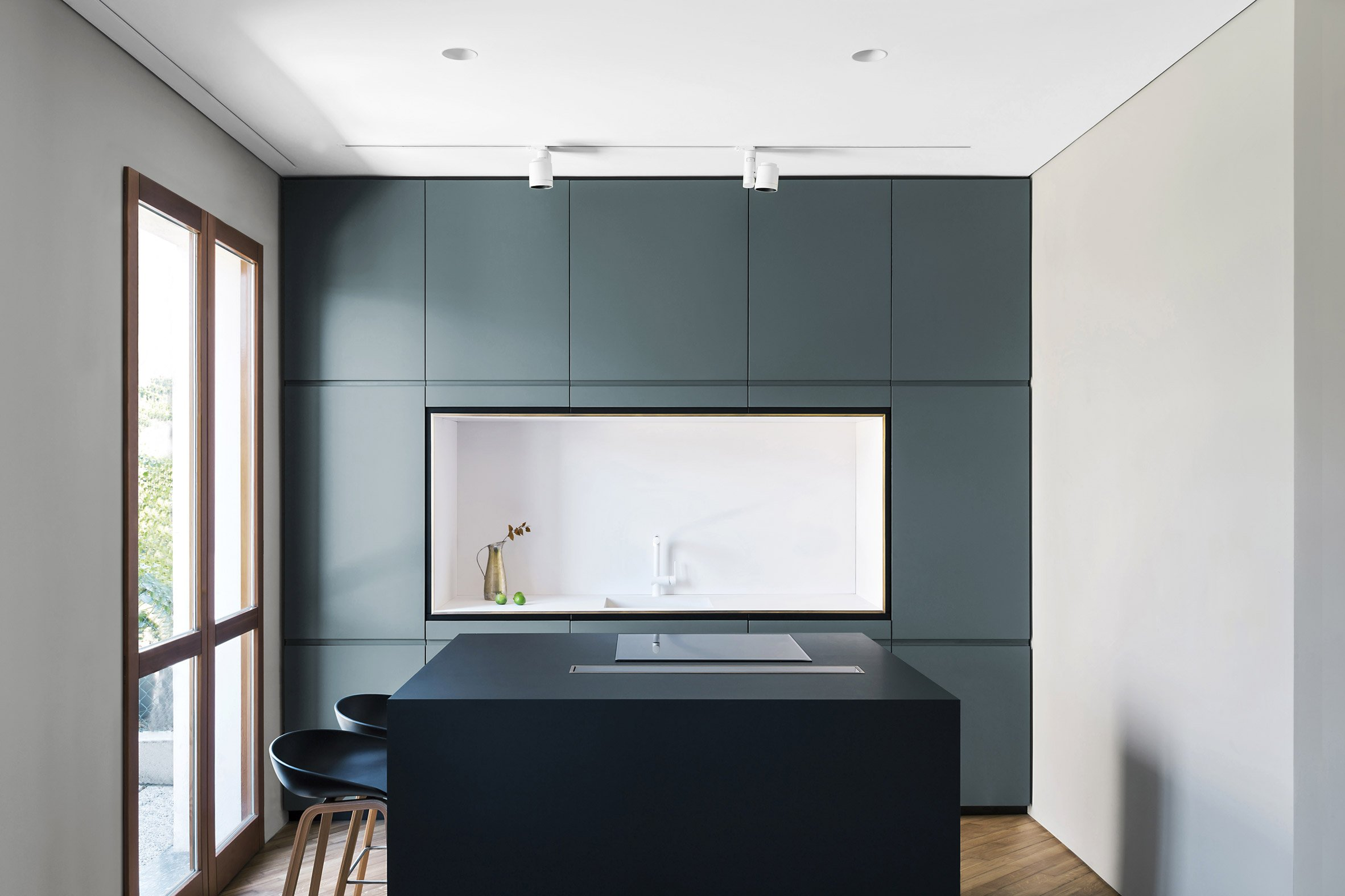 Milan home renovation hides stairwell and floor-to-ceiling cupboards