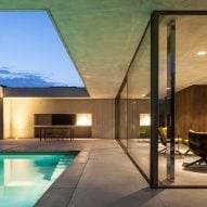 Frameless glazing and concrete canopy shelter pool-side lounge by Steven Vandenborre