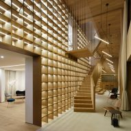 Giant bookcase forms centrepiece of Shanghai sales office by Team_Bldg