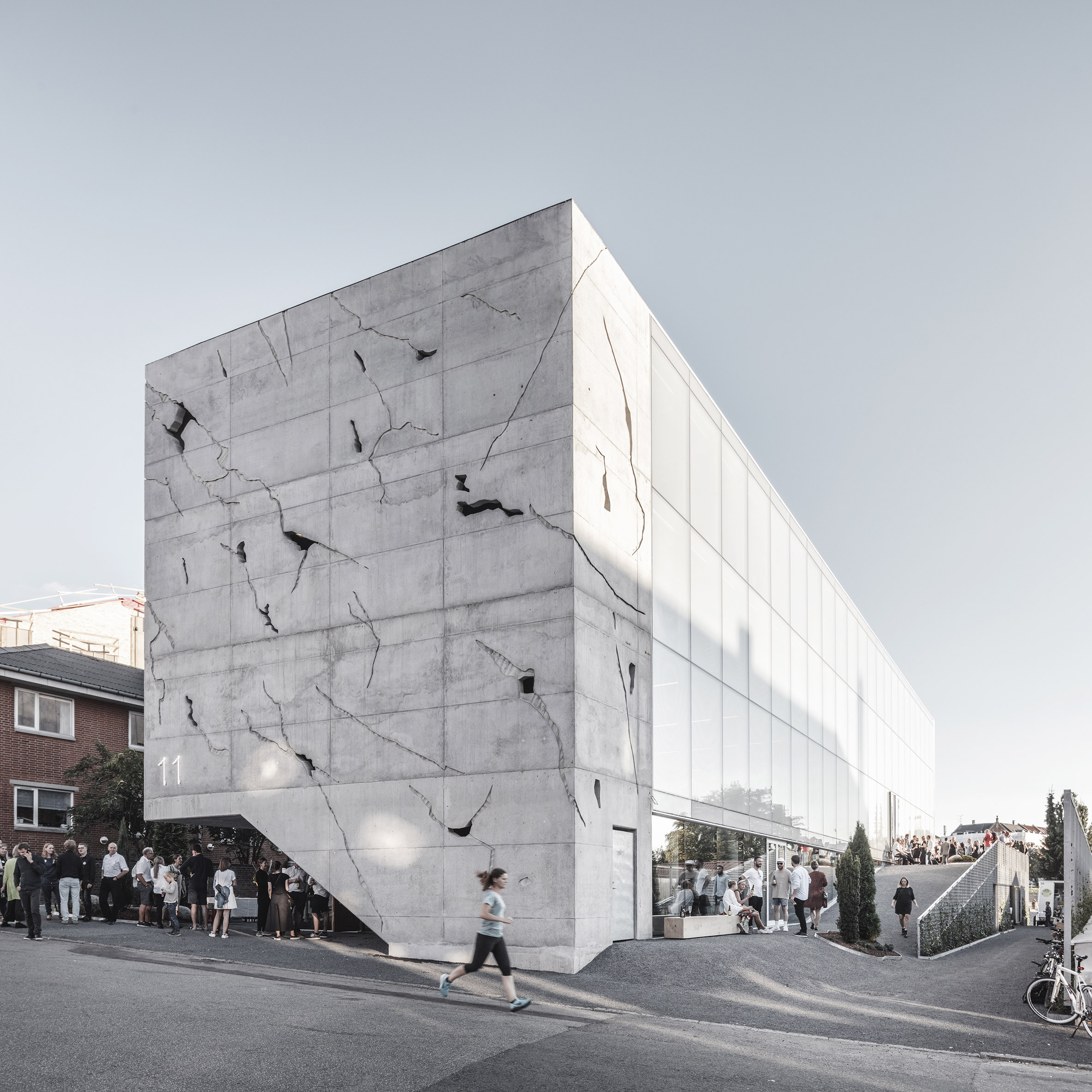 Danish office block by Sleth features cracked concrete facade and external stairs