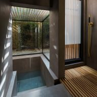 Sunken washroom by Studio 304 allows residents to bathe in a garden setting