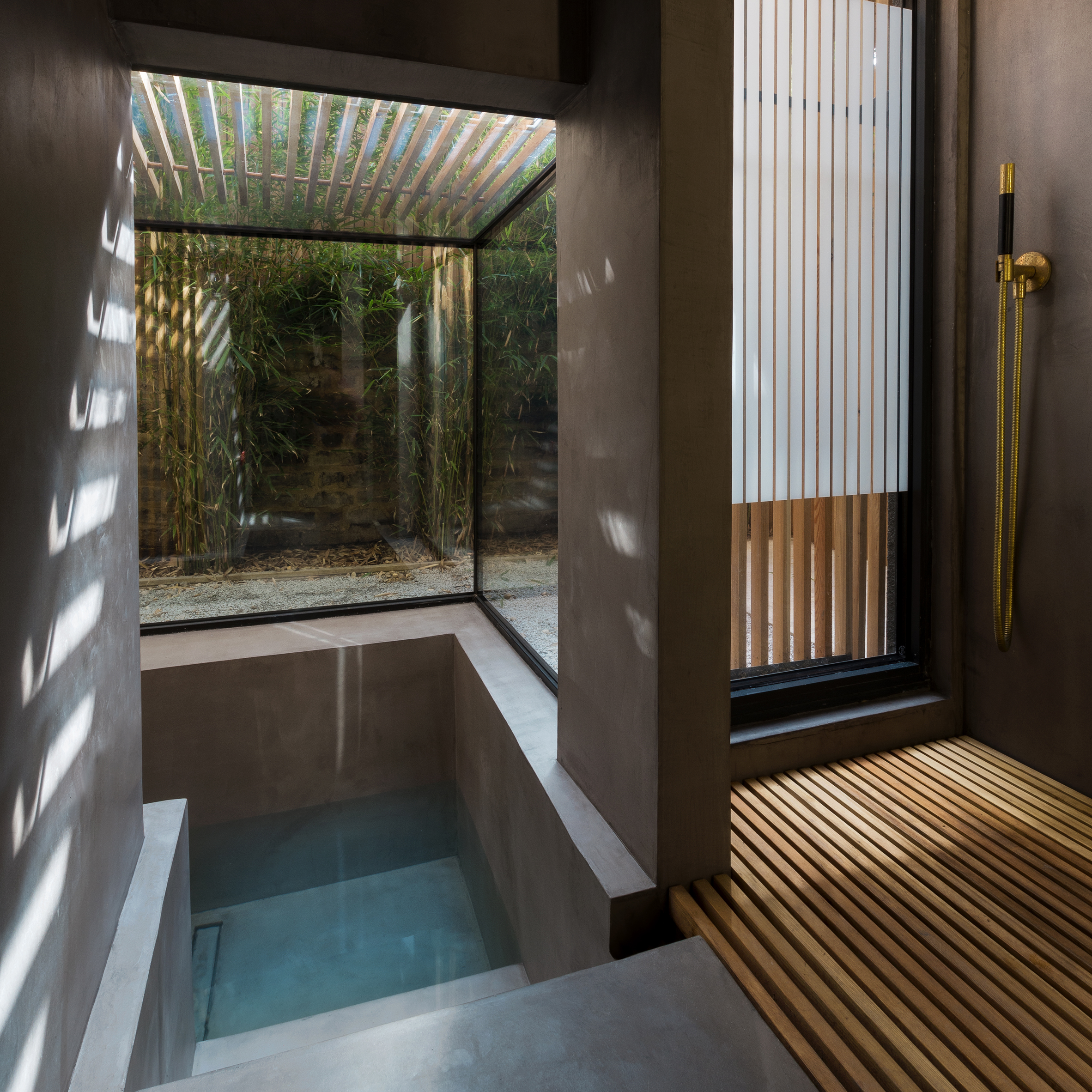 Sunken washroom by Studio 304 allows residents to bathe in the garden