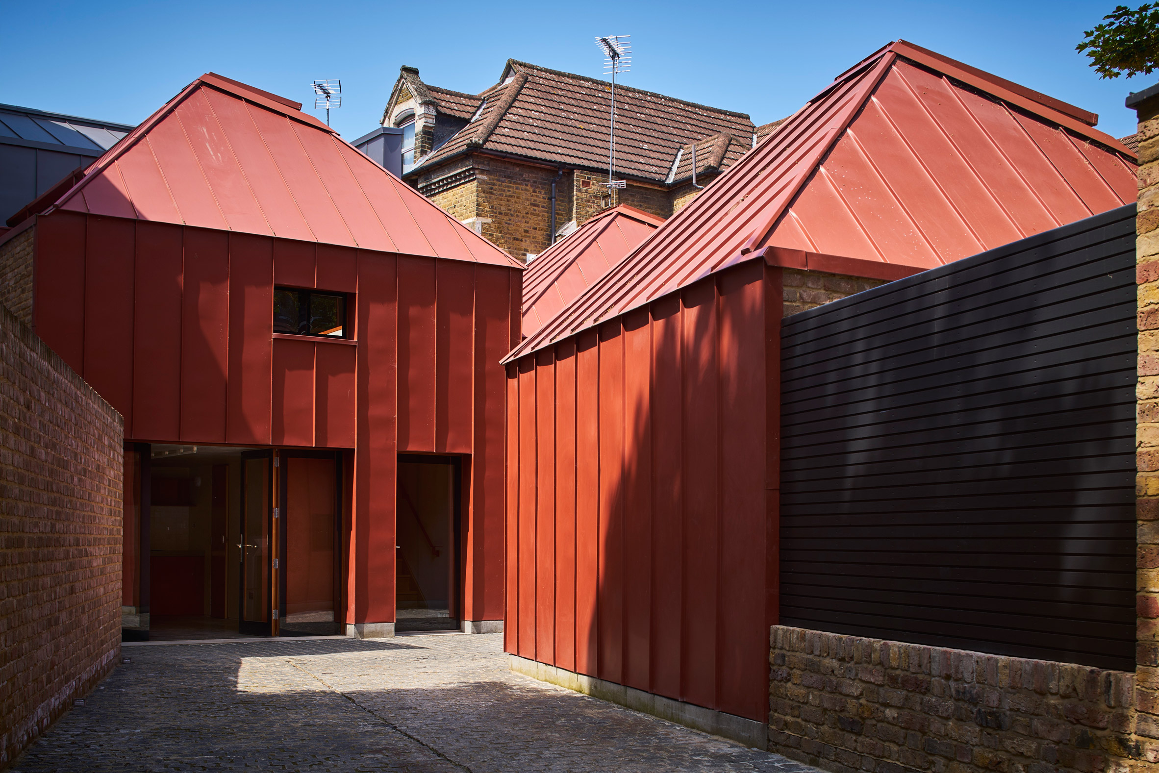 Red pyramidal rooms form Henning Stummel's London home