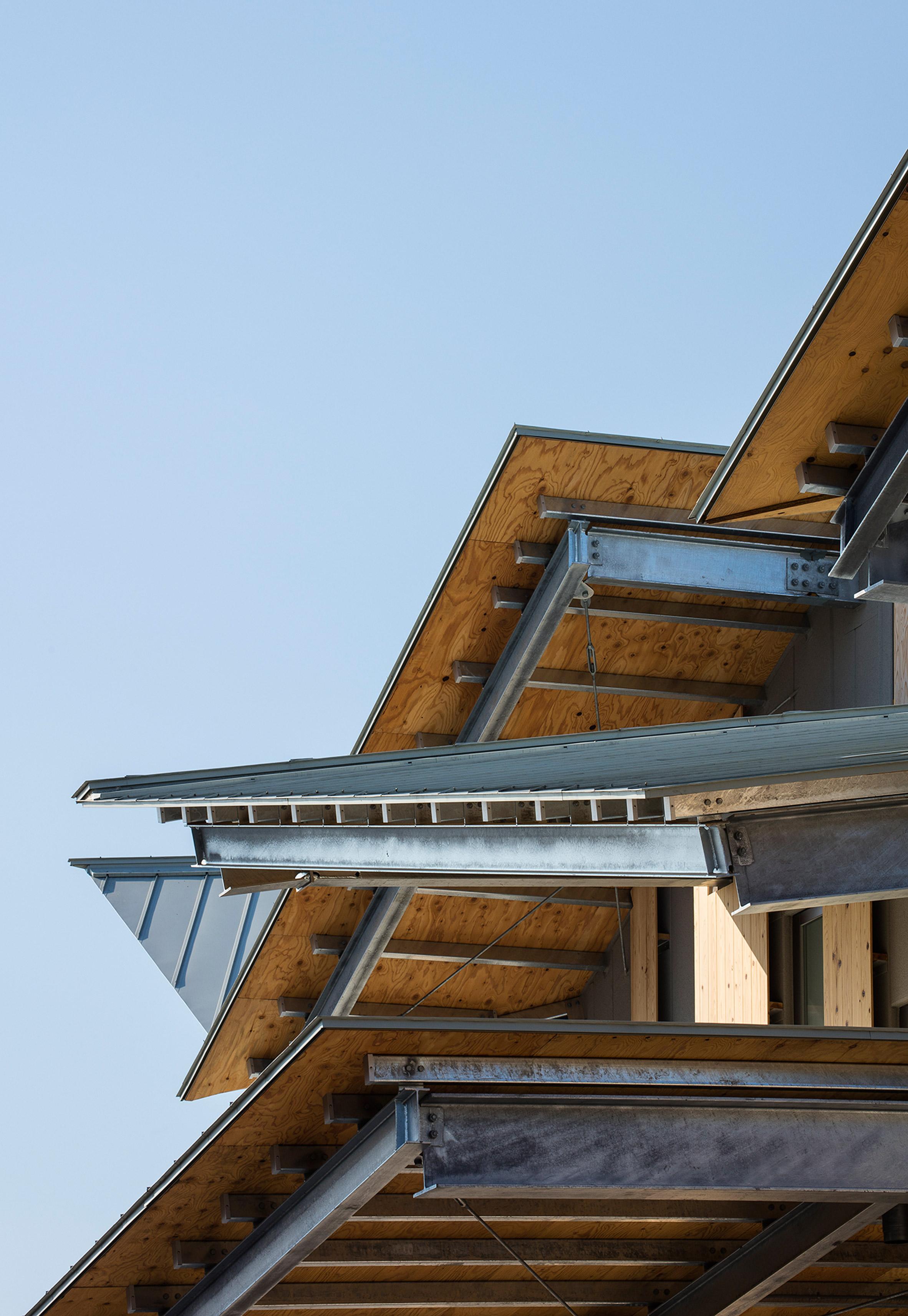 Sharply pitched roofs break up the scale of Kengo Kuma's kindergarten in Saitama