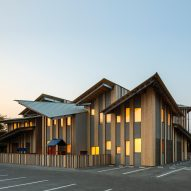 Sharply pitched roofs break up the scale of Kengo Kuma's kindergarten in Saitama