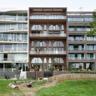 Arches puncture brick facade of Amsterdam apartment block by WE Architecten