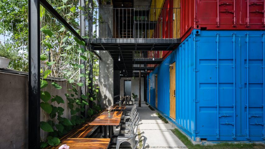 Stacked shipping containers house bedrooms at Vietnam hostel by TAK Architects