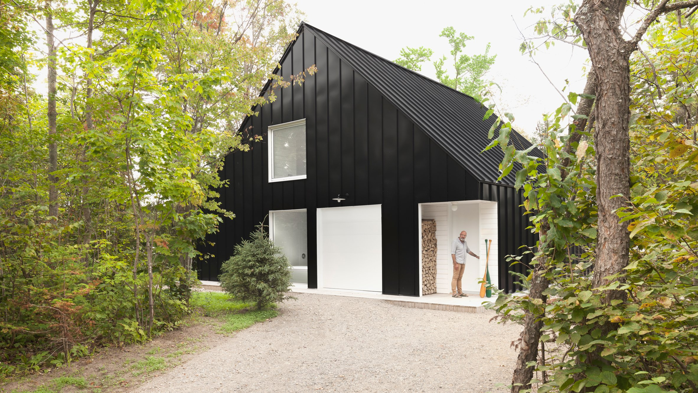 Black beachfront cabin in Canada contains expansive white interior
