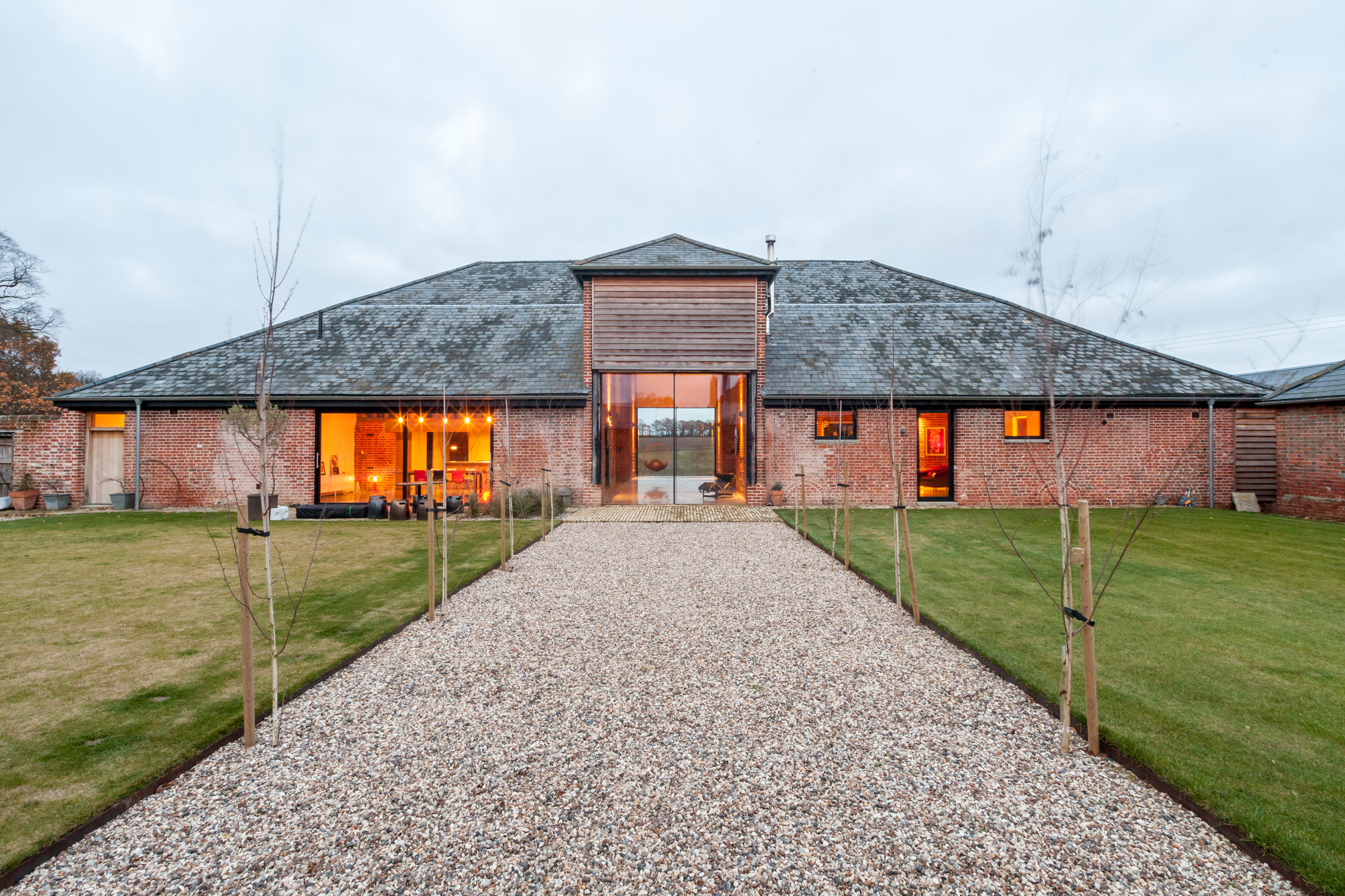 David Nossiter Architects transforms brick barn in Suffolk into spacious home