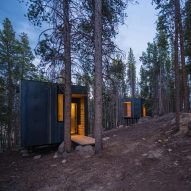 Colorado architecture students build micro cabins clad in sheets of hot-rolled steel