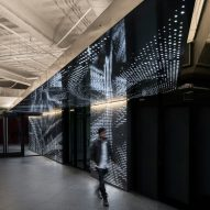 Dotted perforations create glowing patterns for California offices revamped by Tighe Architecture