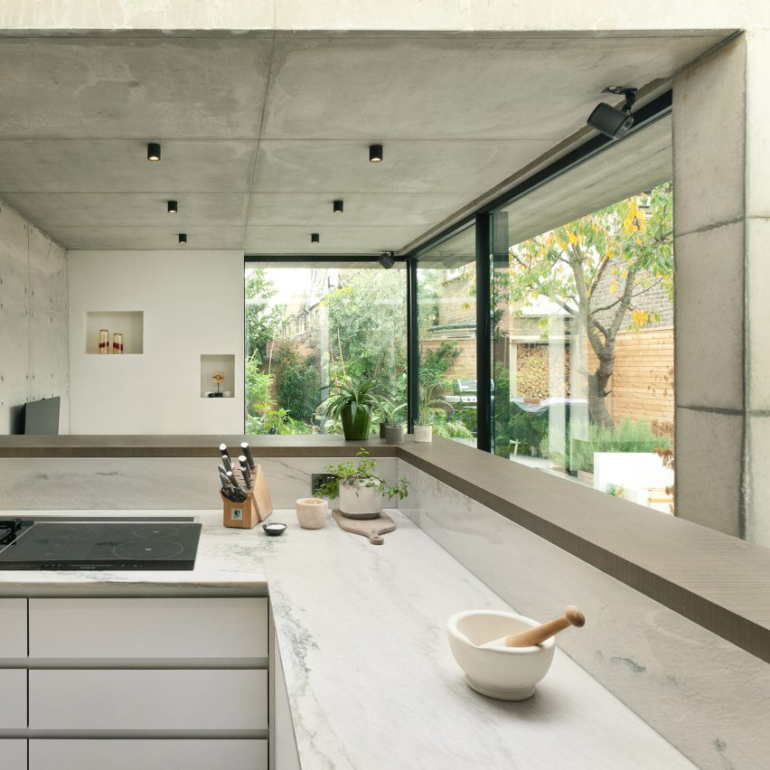 double-concrete-house-inter-urbans-studios-dont-move-improve-architecture_dezeen_sq