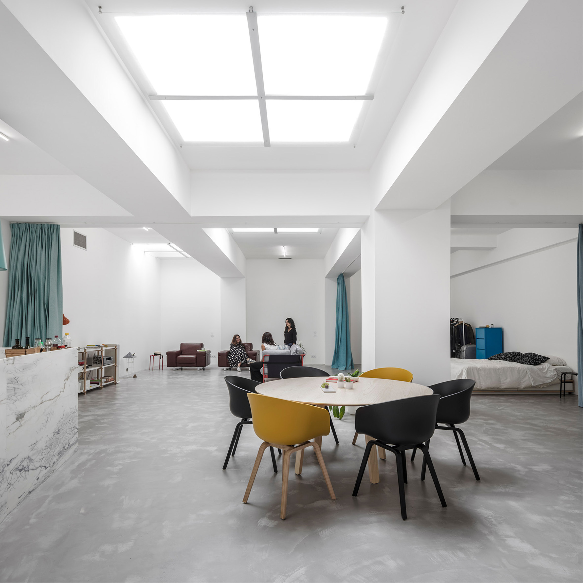 Fala Atelier converts windowless garage into home for young couple