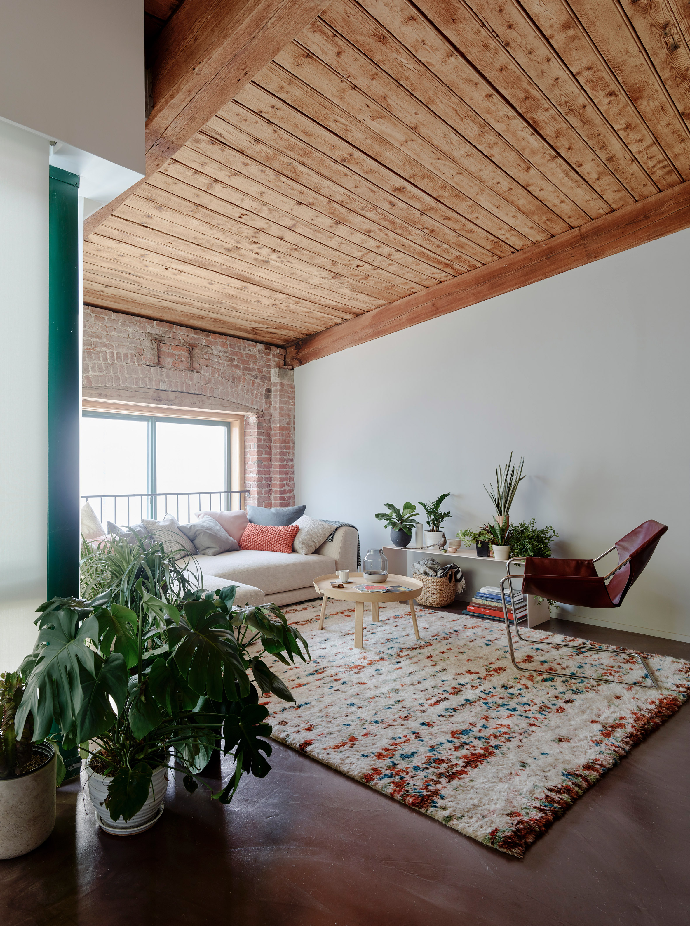 General Assembly exposes wooden beams inside revamped Brooklyn loft