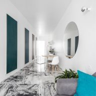 Fala Atelier uses new curving wall to reorganise Lisbon flat