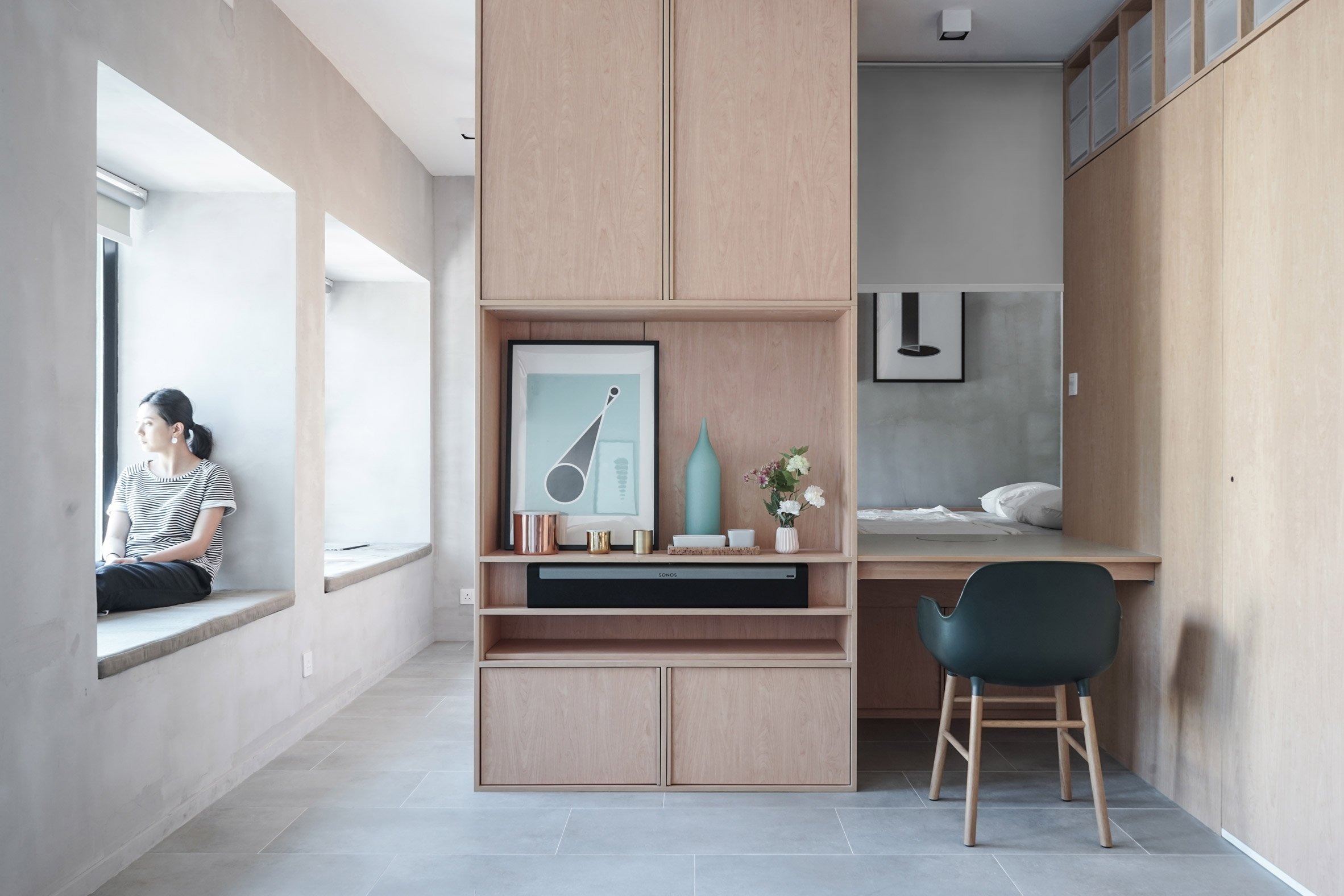 An apartment divided by cabinetry