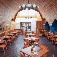 Cedar-clad ceiling arches over San Diego restaurant by Archisects