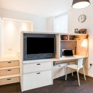 CIAO adds space-saving custom furniture to London micro apartment